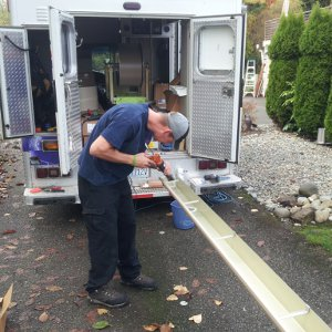 forming a seamless gutter on our Sammamish gutters truck